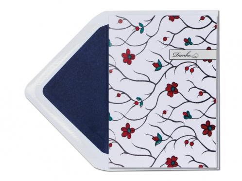 Danksagungskarten mit floralem Muster und dunkelblau gefüttertem Umschlag.