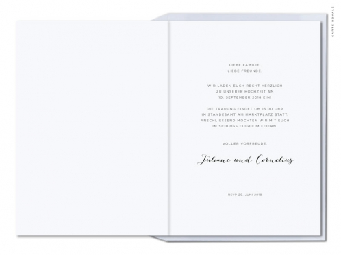 Einladungen mit gezeichnetem Ginkoblatt und gold geprägtem Herz.
