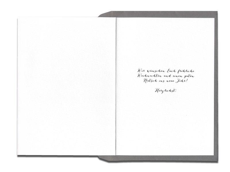 In schwarz-weiß gedruckte Einladung mit gold geprägter Schneflocke.