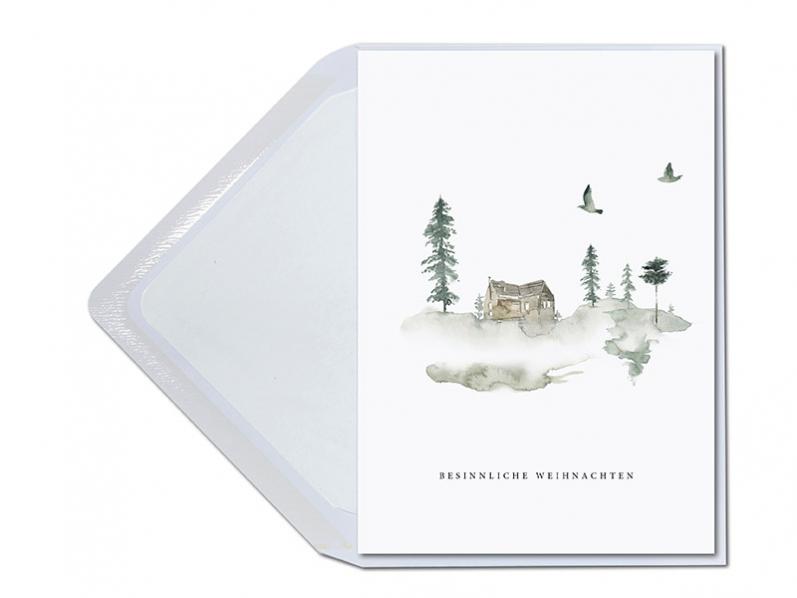 Vorweihnachtliche Weihnachtsgrüße mit gemütlich gemalter Holzhütte unter Tannen in Aquarell. Gedruckt auf GMUND Papier inkl. Kuvert.