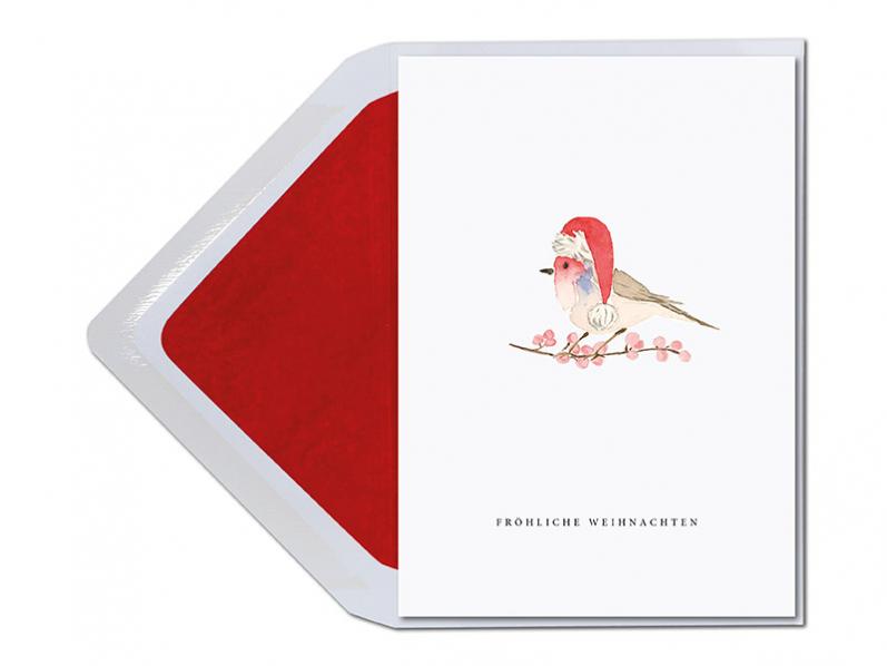 In Auquarellfarben gemalter Vogel mit Weihnachtsmütze auf einem Beerenzweig. Gedruckt auf Feinstpapier inkl. Umschlag.