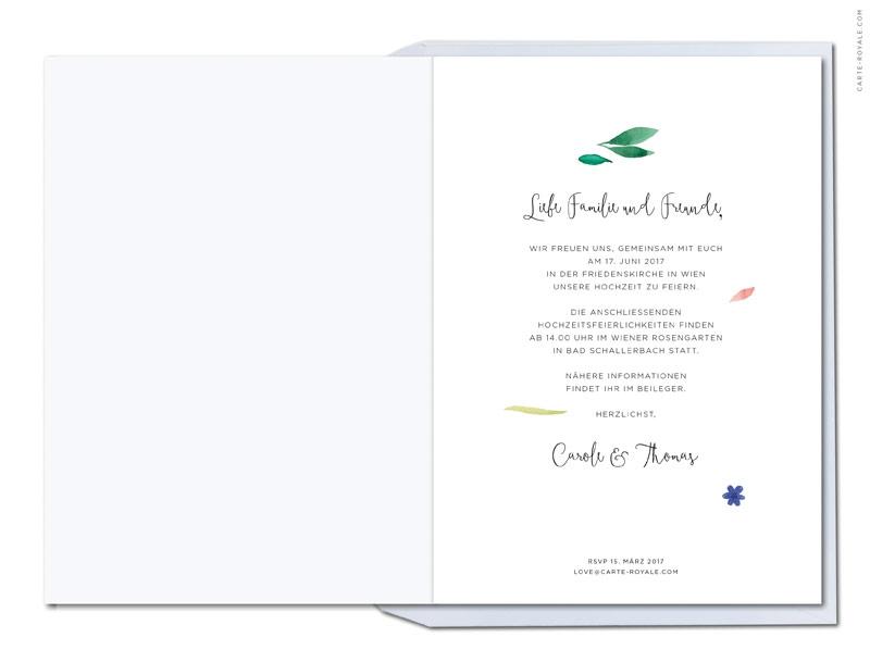 Kaligrafie Hochzeitseinladungen mit gemaltem Blätterkranz.