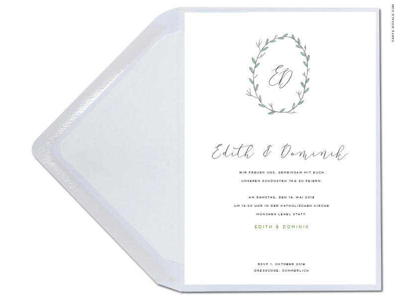 Hochzeitseinladungen mit grünem Kranz und Initialen.