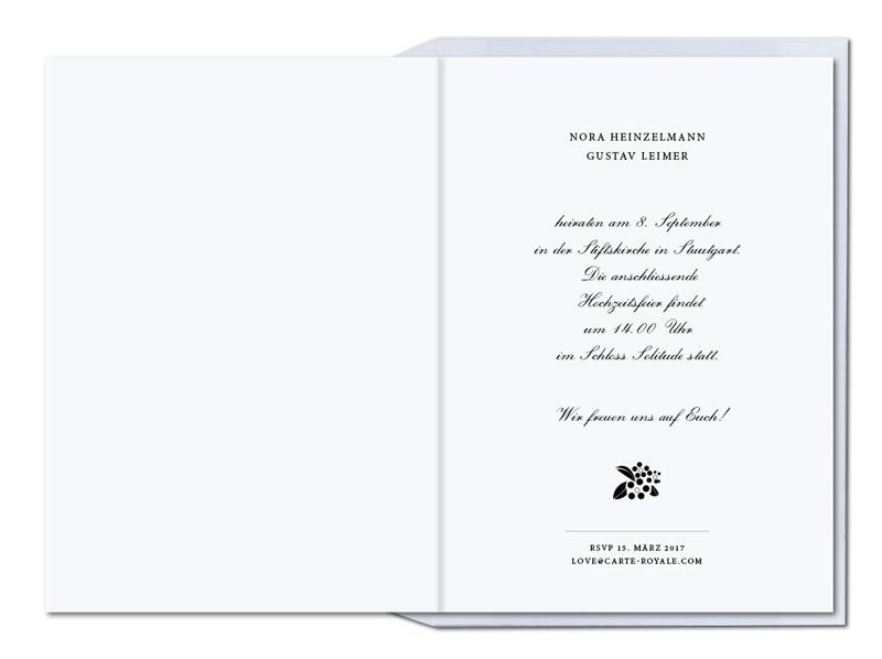 Gold geprägte Hochzeitseinladung mit Hollunderzweig.